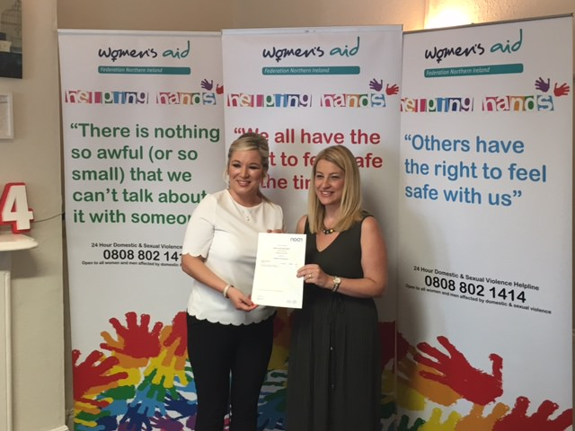 Michelle O'Neill presents Helpline staff member Kathleen with her NOCN Domestic & Sexual Violence Practitioner certificate